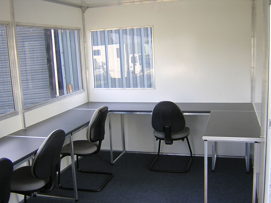Commentary Boxes | Interior – All of our units have plenty of worktop space and comfy chairs